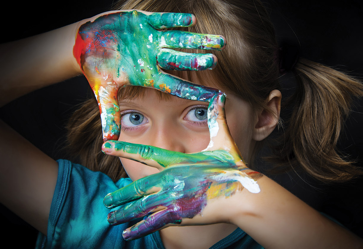 Girl looking through painted hands - We can't find what your looking for
