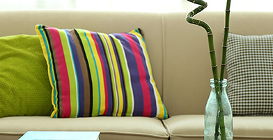 Sofa with bright stripey cushion
