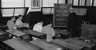 Example of 19th century classroom with staff and pupils