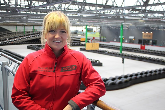 Lynsey McLean - General Manager beside Go kart track