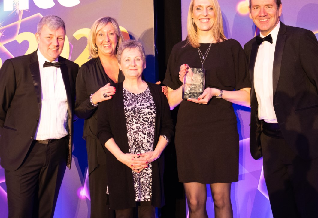 Staff picking up Scotland Excel Award