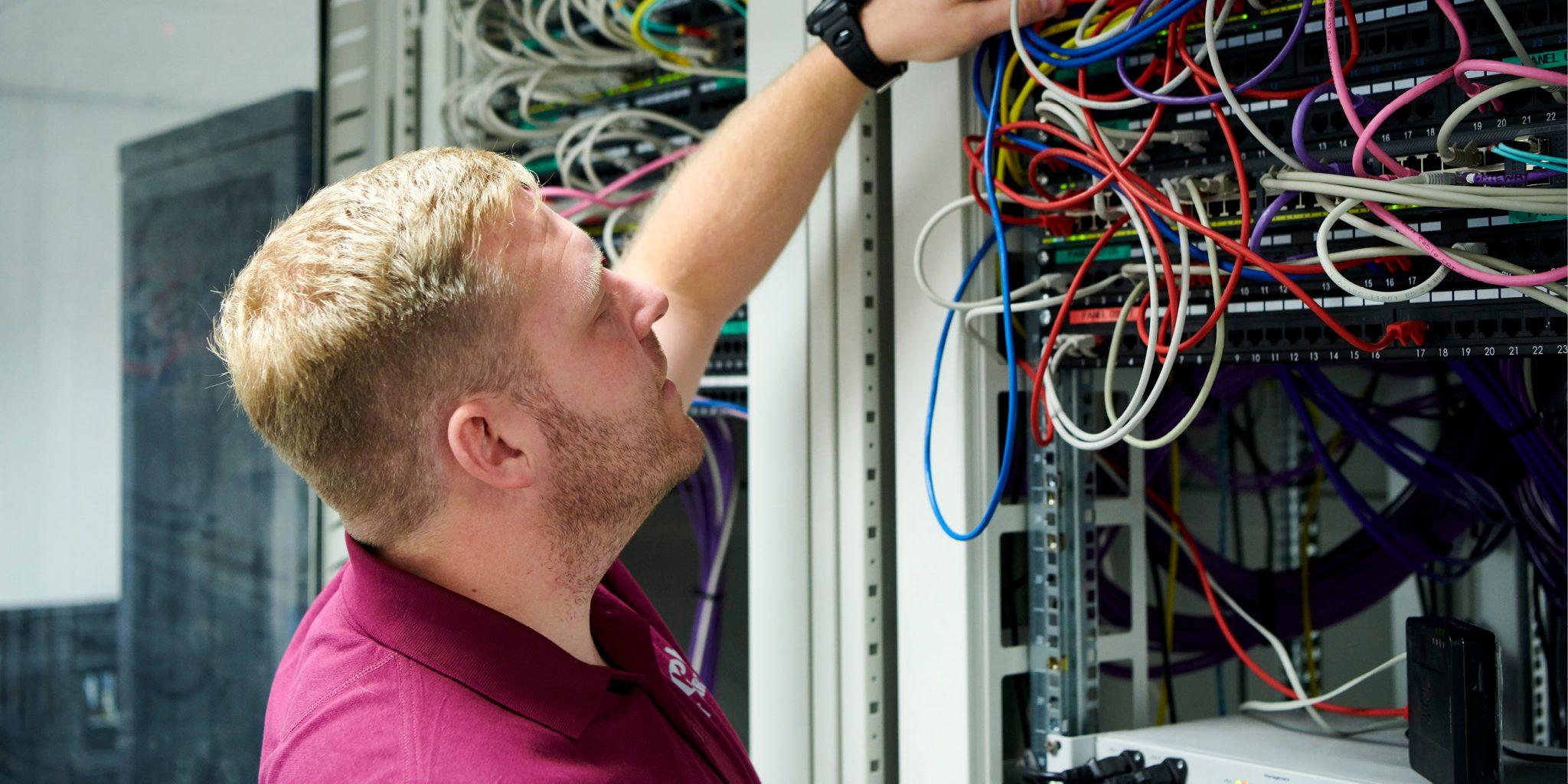 ICT worker working on server